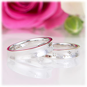 Two wedding bands and a rose